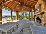 Legacy Mountain Resort has a picnic pavilion next to the pool with a fireplace and a TV.